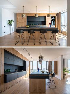 This modern kitchen has black cabinets and countertops that contrast the wood, while brass accents add a touch of glamour. This modern kitchen has black cabinets and countertops that contrast the wood, while brass accents add a touch of glamour. Home Decor Kitchen, Interior Design Kitchen, New Kitchen, Kitchen Modern, Functional Kitchen, Kitchen Wood, Awesome Kitchen, Kitchen Ideas, Beautiful Kitchen