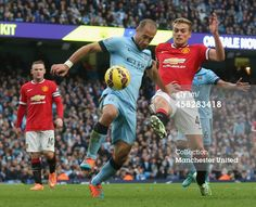 James Wilson of Manchester United in action with Pablo Zabaleta of Manchester City