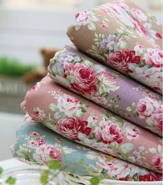 Need to find more fabric like the one on the bottom. Blue floral print, pink roses, and greens. Please comment if you know where to find it online. Thanks