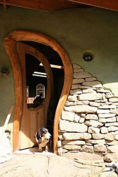 This organically shaped door was built by Kate and her daughters plus lots of helping hands along the way. Hand building your home gives you the opportunity to add custom features.  Photo from www.cobworks.com/gallery/