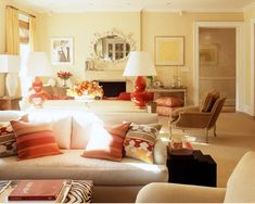 In a very large room, matching sofas back-to-back create two seating areas. I love this arrangement with a sofa table and a pair of lamps in between the two sofas.
