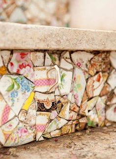 .magical mosaics out of tea cups and pretty printed plates.