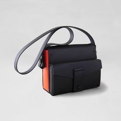 NEON ORANGE POCKET STUDDED SATCHEL by Fleet Ilya