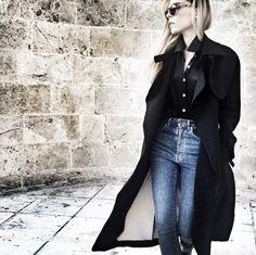 long coat/black shirt/high-waisted denim