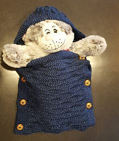 A simple baby cocoon worked in a rectangle with light weight yarn. Good for use in car seats.