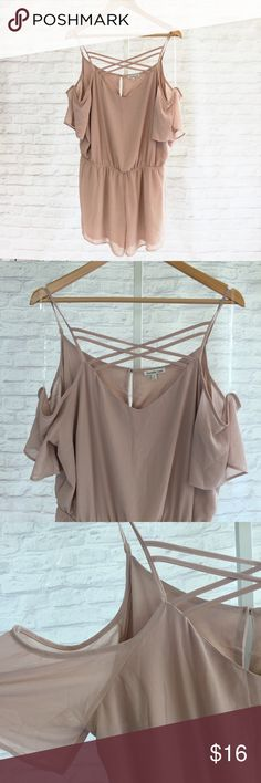 Mauve Romper Cute mauve romper from Charlottle Russe. Very good condition. Only worn once. The front has a criss-cross detail and it's very light and flowy and has an open shoulder but has mesh arm sleeves as well. Charlotte Russe Dresses