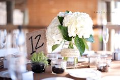 Love the burlap table numbers and the mason jar centerpieces...