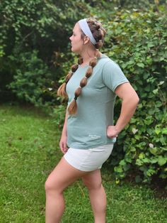 BLUE ANGELS CUT-IT-OUT TEE Looking to add a touch of the BLUES to your wardrobe? Then this shirt is for YOU! Soft, subtle, and stylish! Sage green Sizes S-XXL Embroidered with 'Blue Angels' 'Pensacola' Features sylisth 'cut-out' on back of tee.
