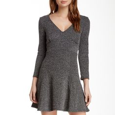 NWT Free People Empire Waist Long Sleeve Dress This textured long sleeve v-neck dress is the perfect seasonless dress! Flirty, flared skirt in a tweed print. Pair with a pair of short boots and you're off! Free People Dresses