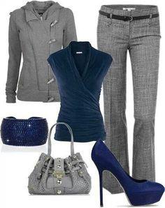 Blue sleeveless shirt gray slacks and jacket.