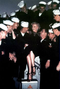 Marilyn Monroe with adoring Service Men. ♥ you can also see this picture  and more......Marilyn  Monroe  in Colour ~ facebook