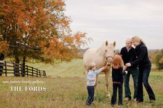 A horse is a horse of course of course...  Love the tree, the horse, the family having fun together...pretty!