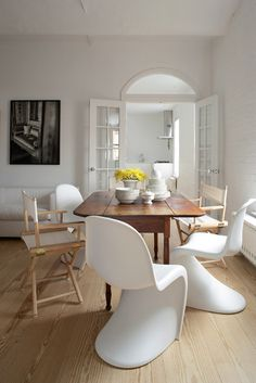White chairs, dark table
