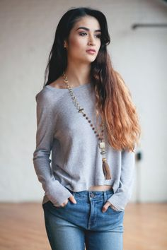 The casual look we love this fall is a 70's inspired wide legged jean and a cropped high-low One Grey Day sweater with back button detailing. This is a look you can recreate with a variety of combinations and we have tons for you to pick from. All of our sweaters are insanely cozy, you will want them all! Finish the look with a statement tassel necklace and you're ready to go!