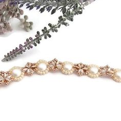 Details An elegant Spring Summer bracelet that's perfect for a wedding, a prom, or anniversary. You'll love wearing this delicate light weight bracelet on your special day. A luxurious flower bracelet that offers a beautiful contrast of white, gold, and rose gold. A bead woven design that is sure to captivate your audience. I designed this bracelet using a pattern by Beadifulnights . I started with white SuperDuos that have two colors (white and golden brown) to them. I love the u Crystal Bracelets, Link Bracelets, Crystal Beads, Handmade Wedding Jewellery, Wedding Jewelry, Summer Bracelets, Cameo Necklace, Flower Bracelet, Swarovski Pearls