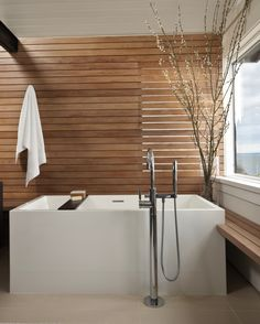 Wood Paneled Bath with White Soaking Tub in Spa Style, Remodelista