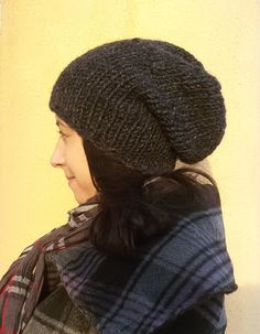 This hat is chunky hand knit in an expressive rustic manner in order to be unique and stylish. Its designed to be worn as a trendy accessory to