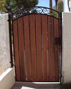 Possible design for a privacy screen in front of house arched pedestrian gate showing redwood composite and black steel Wooden Gate Door, Wood Fence Gates, Metal Garden Gates, Wrought Iron Fences, Fencing, Front Gate Design, Fence Design, Arch Gate, Entrance Gates