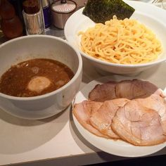 """This restaurant is located right next to JR Shinbashi Station. Their signature dish is """"tsukemen."""" The dipping sauce features the characteristic salty-sweet taste of a seafood-based broth. During lunch time customers can choose for free between an egg as a topping or rice.  Shop:Shinbashi/新橋 Price:1140JPY  Address:1-13-5ShimbashiMinato-kuTokyo  #dippingnoodles  #tukemen #ramen by japan_ramen_mag"""