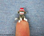a tiny little sock monkey