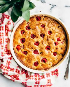 Pistachio-Raspberry Cake. This tender pistachio-raspberry cake (actually a buckle) is dimpled with fresh fruit and best eaten with a spoon, dolloped with a cloud of whipped cream.  Ground pistachios make it extra tender, adding a wonderful, sweet nuttiness.  And did you know the difference between a buckle, a crumble, a crisp, a cobbler and a brown betty?