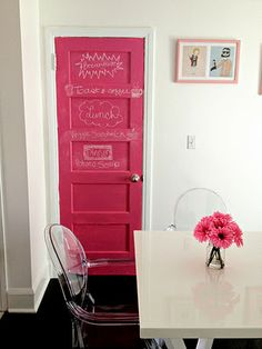 Pink chalkboard painted door, & Louis ghost chairs. I'll pass it off like it's for my girls, but it's totally for me.