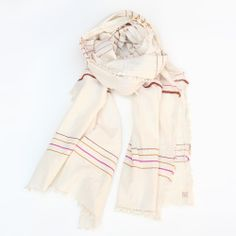 Complexion-flattering white cotton scarves.
