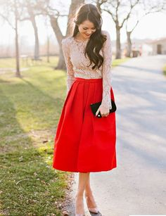 A-line textured knee length skirt red. Cream crop long sleeved lace top. Party wedding event outfit autumn winter spring.