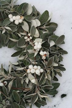 Tallow berry and sage leaves wreath. Get the guide to wedding bouquets with berries here: http://www.mywedding.com/articles/a-guide-to-wedding-bouquet-berries/