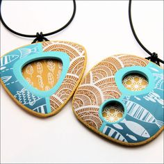 Screenprint polymer clay pendants.  Love the color combos.
