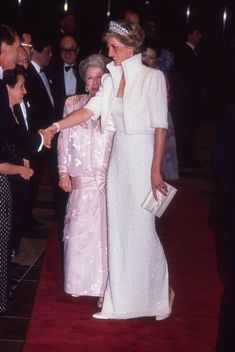 One of my favorite looks from the late Princess Diana; wearing a white beaded gown and matching jacket. She glows! Love the Cambridge tiara. #CelebrateSparkle #PrincessDiana #Diana