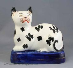 "Laying Cat - Black & White Spotted Cat Laying on a Base. Circa 1860. 5-5/8"" long and 5-1/2""."
