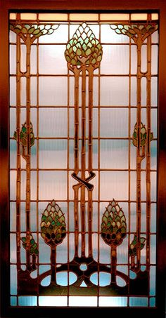 Art Nouveau windows of the first floor of the Hotel Statler in Buffalo (1905-1908) featured designs in opalescent (colored) glass framing clear prismatic (ridged) glass, designed to refract light into the interior. This is one of two windows once located in the northwest corner of the lobby, above the telephone booths.