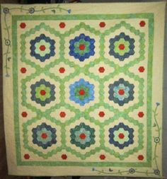 Grandmother flower Garden from a pattern by Susan Getman in July 2008 Fons and Porter Love of Quilting. EPP and hand quilted
