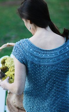 Raindrop by Jennifer Wood in Knitty. If only I had the upper arms for cap sleeves.  More gym time in my future.