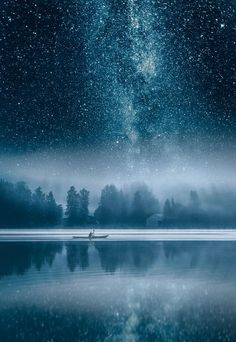 Milky way over the misty Vanajavesi lake in Hameenlinna, Finland