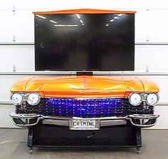 """CALL NOW! (727)-827-8268 This is NOT a cheap plastic copy. This is the REAL CAR! -Watch your friends reaction when you click the remote and a 65"""" hidden LED TV raises by a powered lift from the 1960 C"""