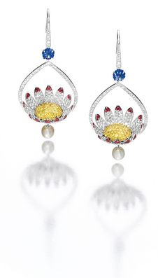 Pair of Gem-Set and Diamond 'Lotus' Pendent Earrings, Michele della Valle: Each designed as a lotus flower extending to a pear-shaped frame, set with circular-cut diamonds, yellow sapphires and rubies, to a surmount set with a carved sapphire, suspending a cultured pearl, the diamonds altogether weighing approximately 3.80 carats, mounted in 18 karat white gold.