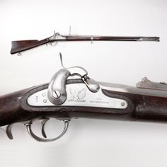 """Whitney 1861 Navy Rifle - It took three years to manufacture all 10,000 Whitney rifles called for in an 1861 contract. Fitted with a special long-range folding rear sight graduated out to 1,000 yards, this .69 caliber longarm's barrel has a large bayonet lug fitted on one side.  In service, it was also known as the """"Plymouth"""" due to its development and testing onboard the USS Plymouth in pre-Civil War years. At the NRA National Firearms Museum in Fairfax, VA."""