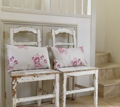 pretty chippy white chairs with linen cushions