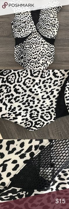 ▫️SALE▫️WHITE AND BLACK PRINT FISHNET BODYSUIT * White/black animal print  * Fishnet cutout details and back * Bottom snap closure * Thong bottom * Pit to pit 32in * 98% Polyester, 2% Spandex. Lowest price listed. Tops