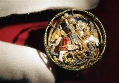 A Flemish hat badge dating from around 1520 and worn by England's King Henry VIII is seen at an exhibition at Windsor Castle, in Windsor, England, to mark the the 500th anniversary of his accession to the throne, Monday April 6, 2009