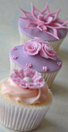 Cupcakes...lavender and pink for a lil' girl's birthday party!  Too cute!