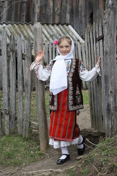 Romanian girl in traditional costume ...