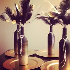 Roaring 20's centerpieces. I probably wouldnt do feathers like that but i like the leaves and pearly! Maybe add twigs .. Or even smaller feathers
