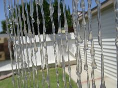 """Homemade icicles for Frozen's icicle forest. Made of string and hot glue. Easy and sturdy enough for the kids to run through. Lengths vary from 41"""" to 73""""."""