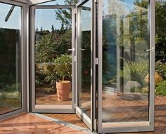CS Glaziers Group are the leading manufacturers of glass and aluminium windows in North Wales. Aluminium Windows And Doors, Glass And Aluminium, Underground Homes, Sliding Glass Door, Glass Doors, Folding Doors, Double Doors, Conservatory, Outdoor Structures