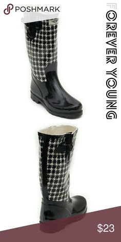 "Women Knee high Rainboots, #1508, Black & White Brand new glossy woman knee-high rainboots by Forever Young. Beautiful checkered design, cotton lining, removable sole. Posh buckle on the calf side. Approx 14"" tall & approx 15"" in circumference. 100% rubber rain boot!!! Taller than galoshes and protect your feet better while you garden or just walk in the fall or winter rain. Not made for wide calves. Run half a size larger than regular shoes. A true statement in ladies fashion! Forever Young…"