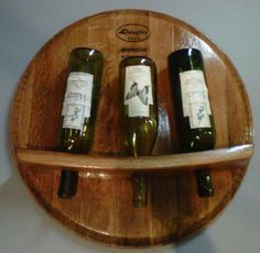 Wine Barrel Head Wine Rack wall mounted by LivengoodWood on Etsy, $85.00