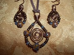 galvinized copper and ceramic and wood beads